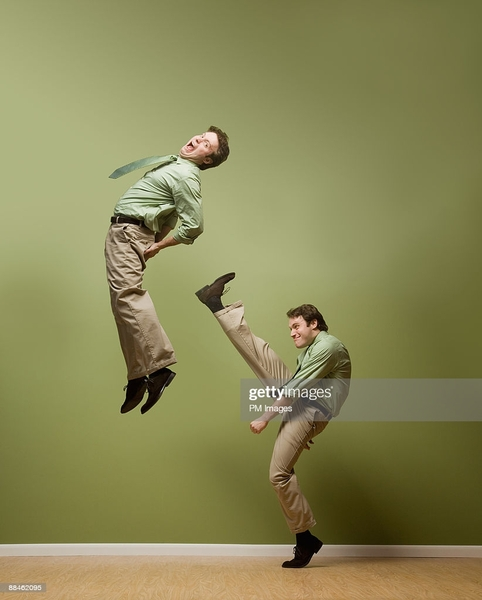 businessman-kicks-himself-picture-id88462095.jpg