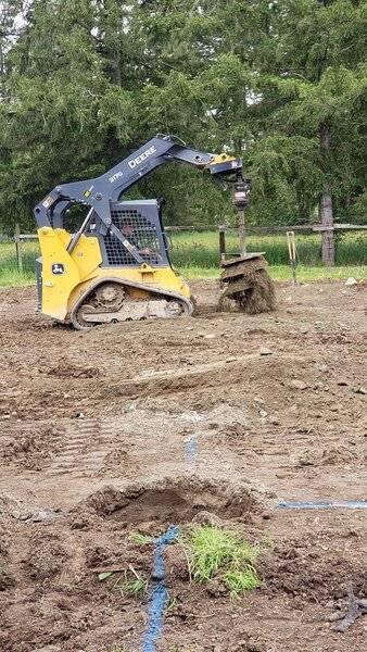 Digging holes for posts.jpg