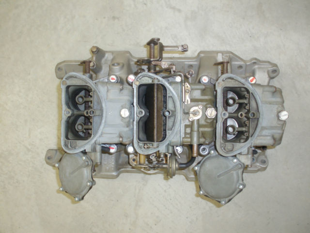 My OE 1970 TA Challenger 340 six pack intake and 4-spd carbs 1.jpg