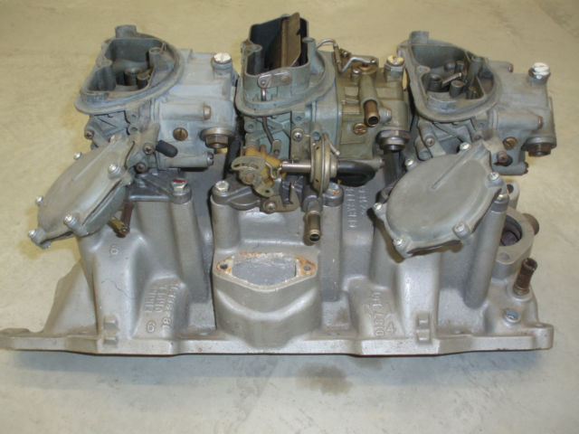 My OE 1970 TA Challenger 340 six pack intake and 4-spd carbs 2.jpg